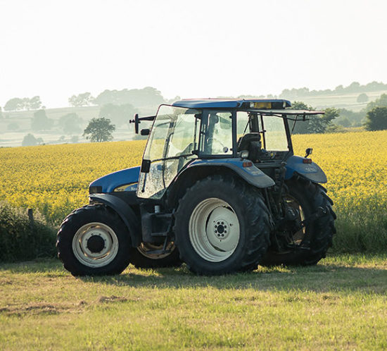 A tractor in a field- Agrisure, Farm & Agricultural Insurance